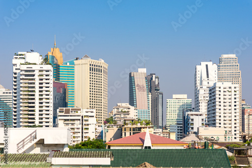 Poster Bangkok View to the skyline of the Watthana district in Bangkok. The business district with many tall buildings is situated at Sukhumvit road, which is one of the main roads in Bangkok and Thailand