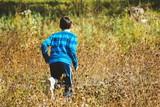 Happy boy posing outdoor at sunny day - 182469140