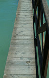 long wooden walkway suspended above the water without people