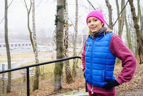 Fotobehang Muziek Teenage sporty girl listening to music outdoor.