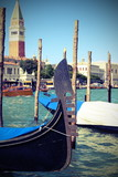 VEnice Italy gondola and in the background the bell tower of San