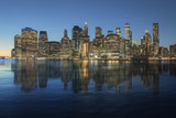 Manhattan skyline reflected in the water of the East River. - 182476141