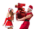 Handsome young man and pretty young woman in Santa Claus hat standing holding colorful festive Christmas gifts to celebrate the season, on white background - 182477108