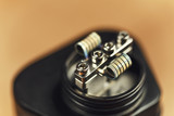 Coil of RDA atomizer for vaping or e-cigarette, vape macro footage - 182479796