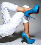 Part of women legs in beautiful fashionable high heels. - 182480595