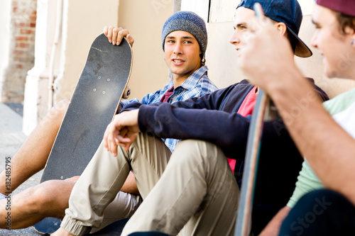 Aluminium Skateboard Skaters having a break at the street