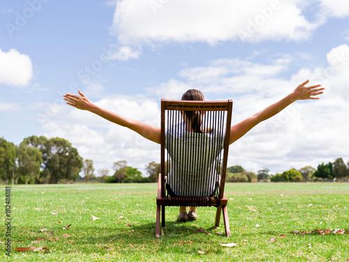 Young businesswoman relaxing during her break in park