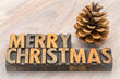 Merry Christmas greeting card in wood type