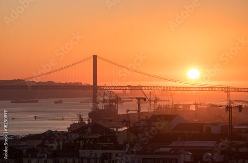Amazing sunset on Ponte 25 de Abril Bridge, (25th of April Bridge) at Lisbon. Portugal
