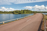 Finnish landscape with road, lake and forest island. Finland - 182514974