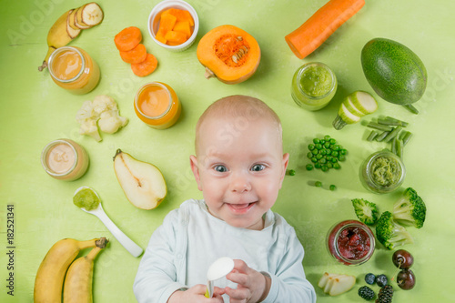 Sticker Colorful baby food purees in glass jars