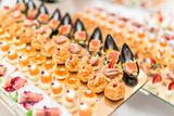Gourmet appetizers: caviar, venison, tuna and salmon. - 182525761