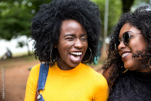 Afro descent girls having a great time together in the park