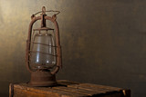 Old Rusty Lantern on the Wooden Desk in the Attic - 182536960