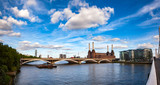 Abandonded Battersea Power Station and Grosvenor Bridge over the River Thames in South West London England in 2013