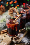 Christmas hot mulled wine with cinnamon cardamom and anise on wooden background, selective focus - 182545937