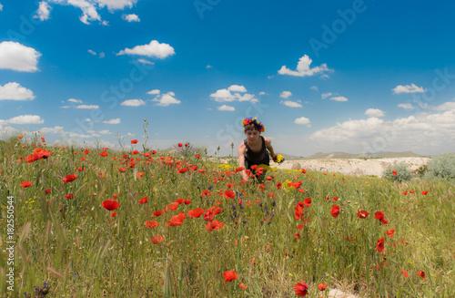 Teen girl in poppy field outdoor
