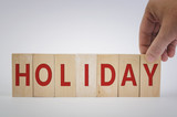 HOLIDAY word made with building blocks - 182558951