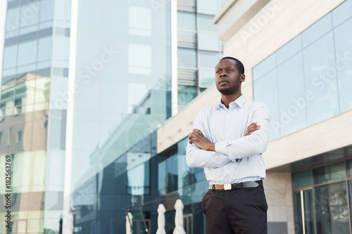 Black businessman outdoors in smart casual ware Poster