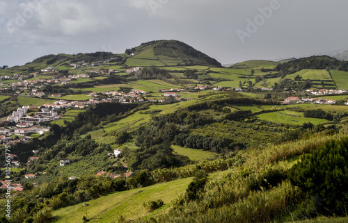 Plexiglas Donkergrijs green fields and cottages inland on the island of Pico in the Azores