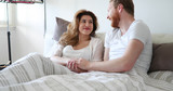 Couple in love wearing pajamas lying in bed - 182567587