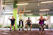 group of people exercising and jumping in gym - 182570133