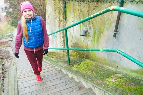 Fotobehang Hardlopen Woman exercising on stairs outside during autumn