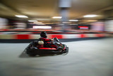 Cart (kart) blurred by high speed, a boy having fun - driving fast, racing, speeding.  - 182578578