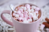 Pink mug of hot chocolate with marshmallows on table, top view - 182586719