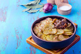 Meat stew topped with sliced potatoes - 182591995
