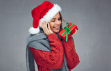 Christmas style portrait of happy woman holding red gift box