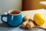 Blue cup of herbal tea with ginger and lemon - 182598373