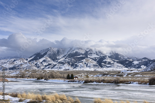 Frozen Yellowstone River in Winter Surrounded by Mountains