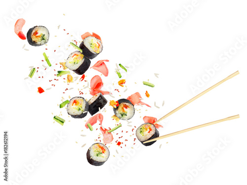 Fotobehang Sushi bar Pieces of sushi fly in the air on a white background