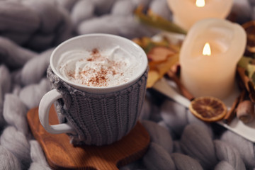 Cozy winter evening , cup of coffee, soft blanket, candles. Comfy lifestyle.