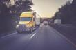 18 wheeler truck on highway at sunset