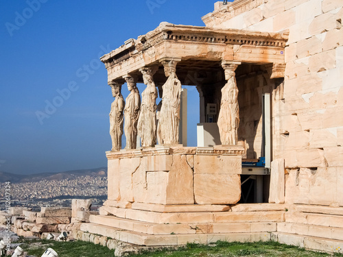 The Porch of Caryatids with greek statues for columns as part of the Erechtheion a top the Acropolis in Athens Greece