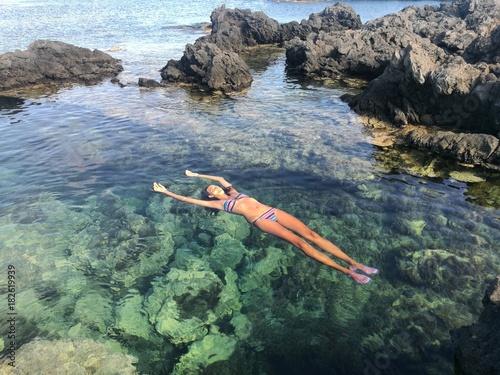 Zdjęcia na płótnie, fototapety, obrazy : Girl in the sea in a summer day