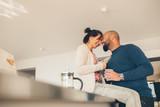 Loving couple enjoying morning coffee at home - 182623940