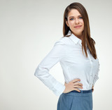 Smiling businesswoman wearing white shirt isolated - 182626316
