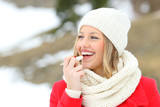 Girl protecting lips with lip balm in winter - 182633580