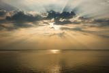 Fantastic sunset with dramatic cloud and beautiful sunbeam