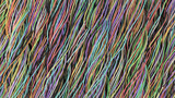 Twisted multicolored cables and wires on black surface - 182648556