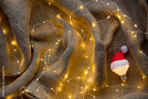Bulb in Santa Claus hat with Christmas Lights