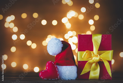 Christmas gift box and Santa Claus hat with heart shape