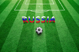 3d Russia letters painted with Russian flag on green textured soccer field with football ball. - 182671580
