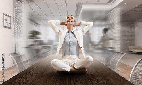 Fotobehang School de yoga Business lady meditating at work. Mixed media