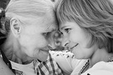 Middle-aged woman hugging her mother in nature. The real emotions of happiness. Mothers Day. Black and white photo. - 182674759