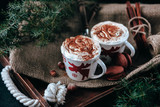 Enamel cup of hot cocoa or coffee for Christmas with whipped cream - 182677972