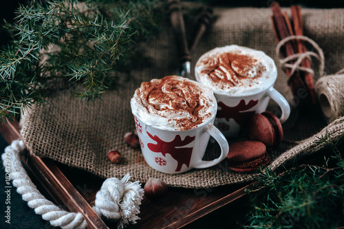 Enamel cup of hot cocoa or coffee for Christmas with whipped cream